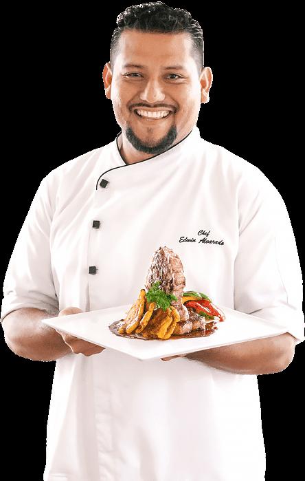 The Guava Limb Cafe Restaurant Belize chef edwin portrait holding food plate